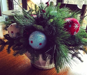 Arrangement featuring felt Christmas ornaments in a stoneware bowl